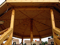 This gazebo was constructed with ponderosa pine hand-peeled D logs and ponderosa paneling on the ceiling